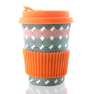 Biodegradable bamboo reusable coffee cup with lid and silicone insulation cover.